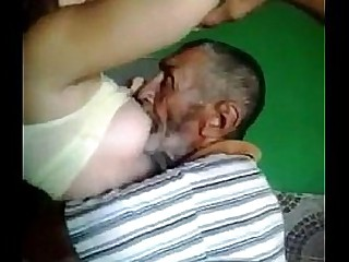 Old man sucking boobs of young girl
